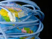 Network cable wrapped around globe depicting connected world